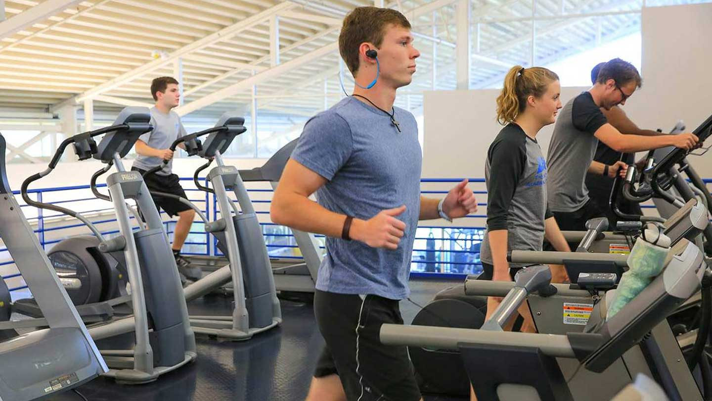 A group of people using fitness equipment.