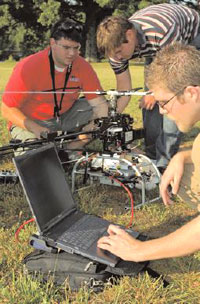 Students with computer controlled helicopter
