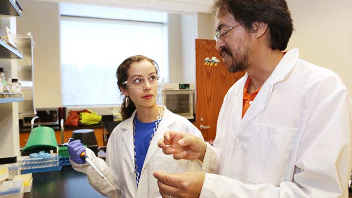 student and professor in a lab