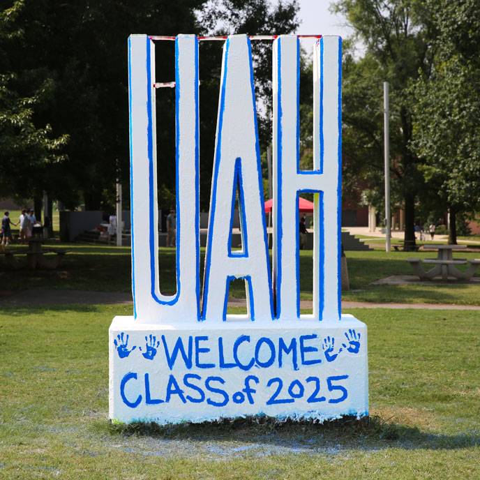 a concrete UAH sculpture with Welcome Class of 2025 painted in blue text