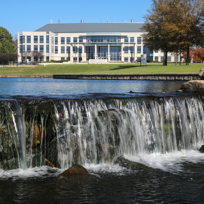 waterfall and the shelby center for science at UAH
