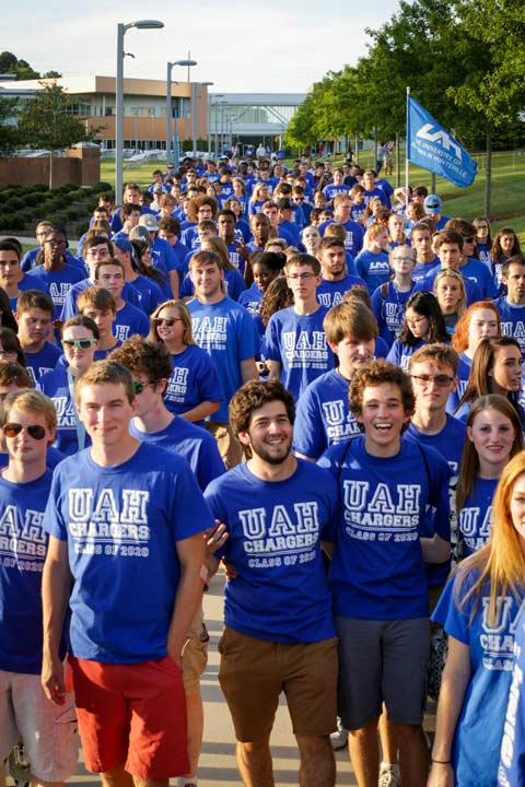 Large gathering of UAH students standing on the greenway