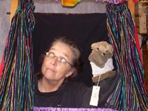 Puppeteer Anne Sue Courtney performs with her puppet.