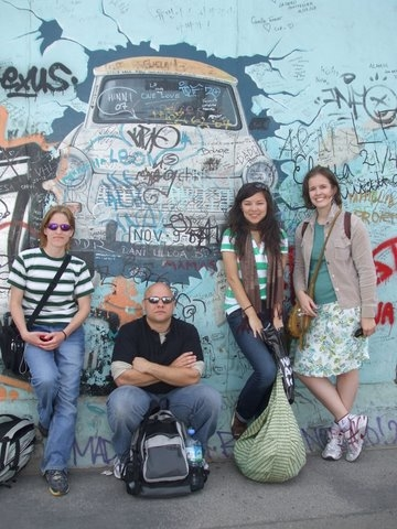 Global Studies students in front of graffiti-ed wall in Berlin