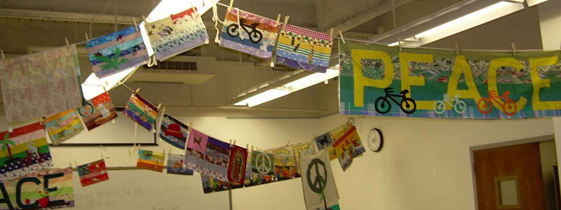 Peace Artwork hung from clotheslines