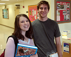 Two undergrad students smiling.