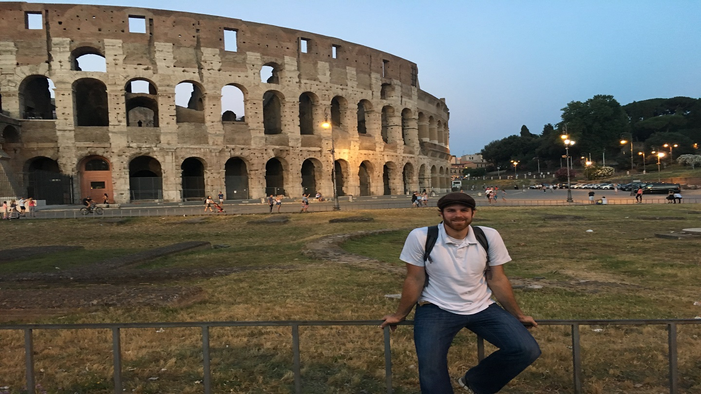 Teacher in front of Roman Colosseum