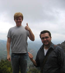 Two students giving thumbs up.