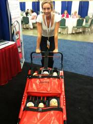 Lydia tries out an infant evacuation cart by Evacu-B