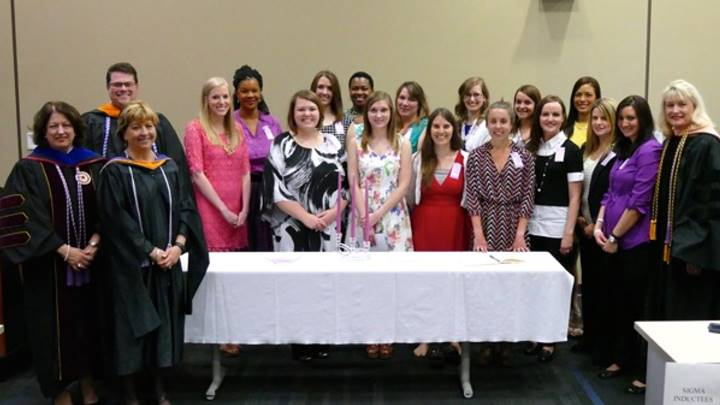 Dr. Ann Bianchi, Mr. Mark Reynolds, Dr. Lenora Smith, and Dean Marsha Adams with the Sigma Theta Tau inductees.