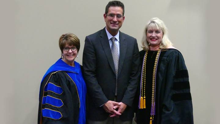 Eddie Damron, recipient of the Research Horizons Undergraduate College of Nursing Award, stands with his research mentor, Dr. Pam O'Neal and Dean Marsha Adams.
