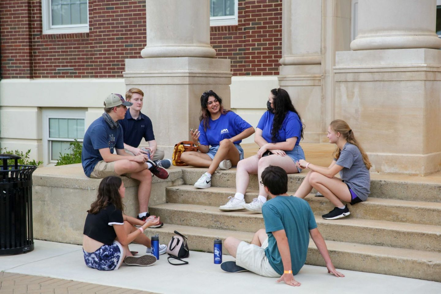 Honors College mentors talking on the front steps of Morton Hall