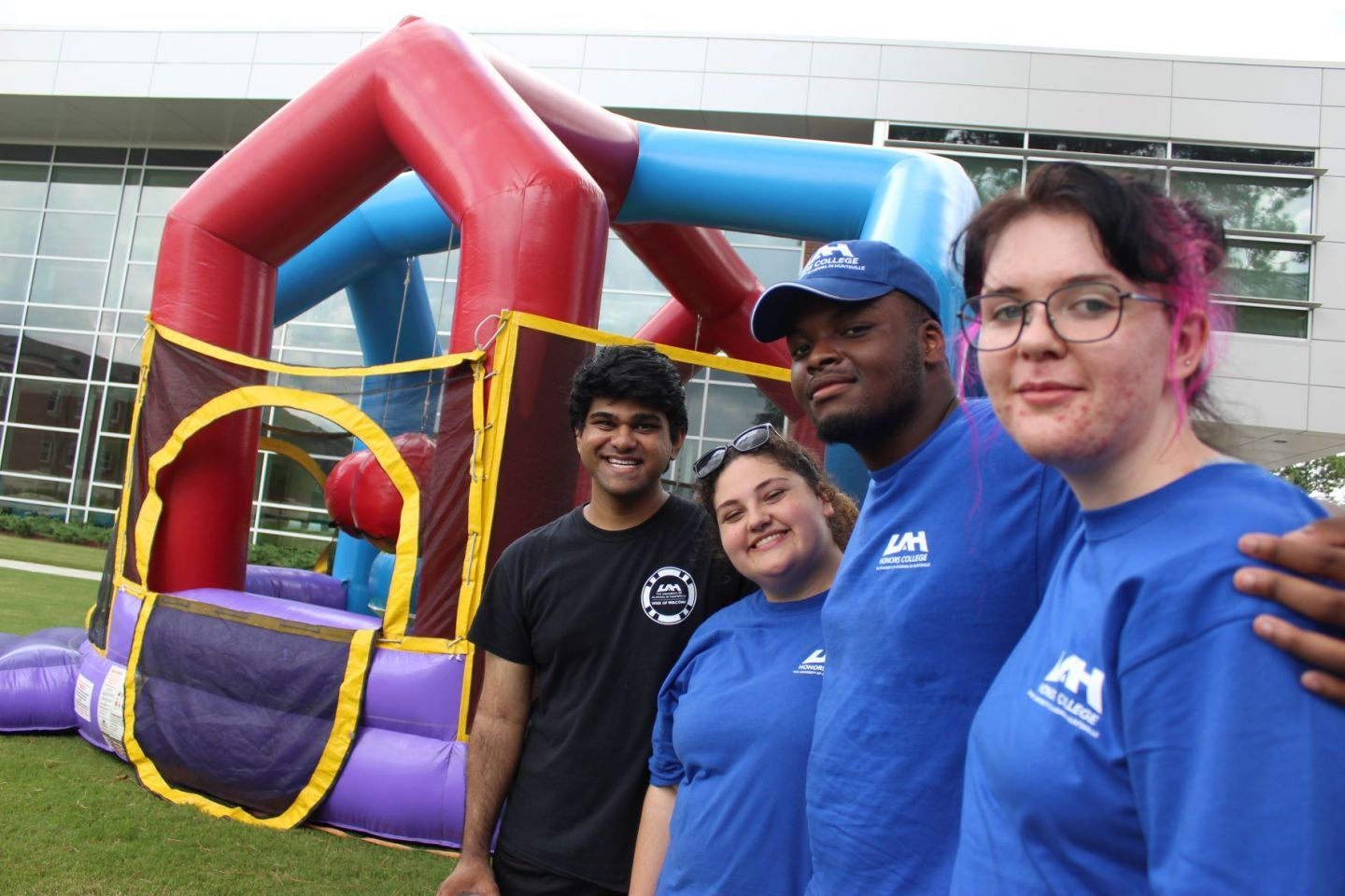 Honors College mentors posing in front of an inflatable bounce house