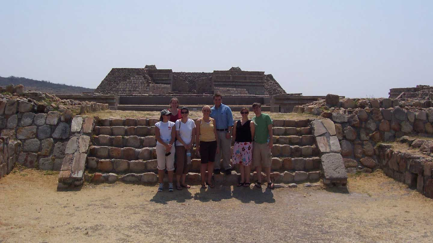 Students standing in front of ancient ruins in Mexico