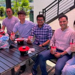 professor and students celebrating at a outdoor restaurant
