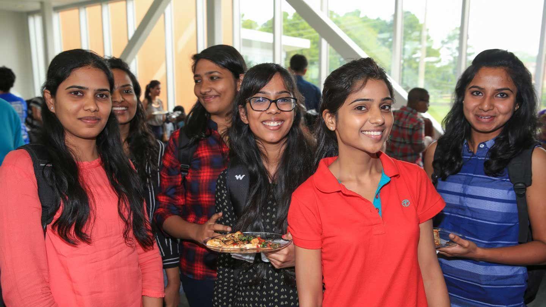 International women students smiling