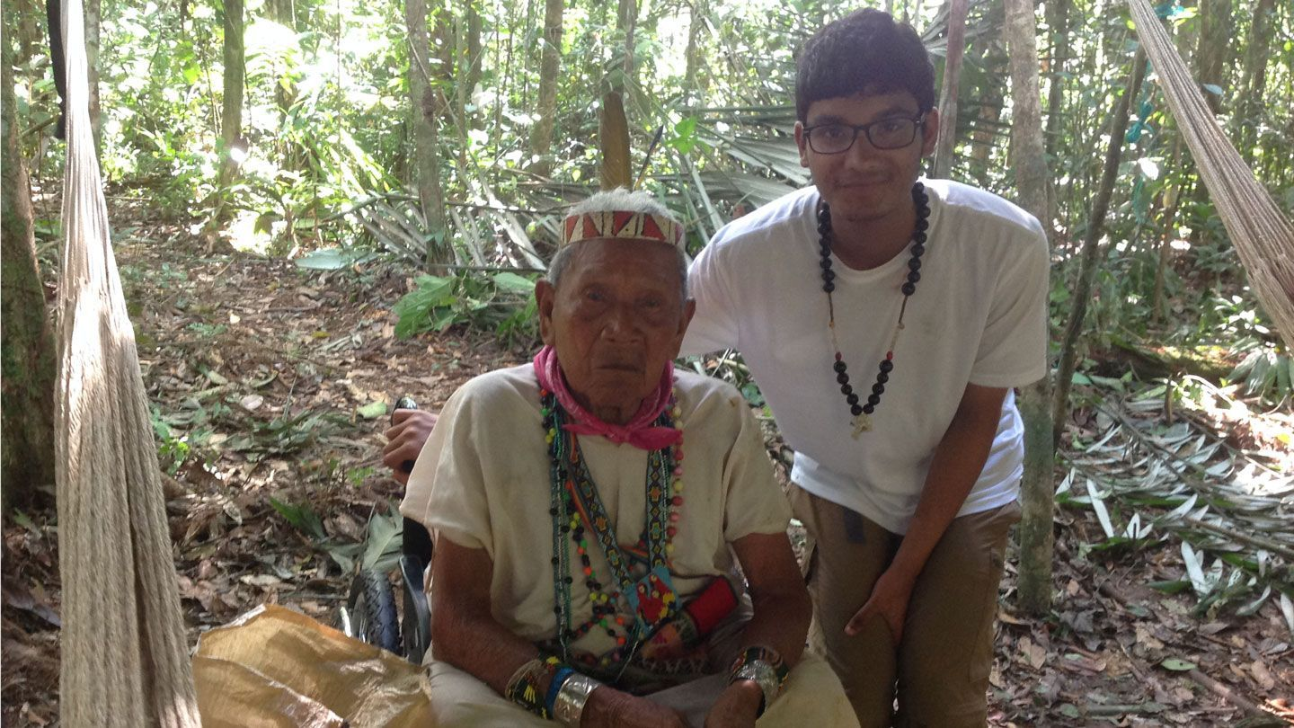 A UAH student meets with a village elder in Ecuador