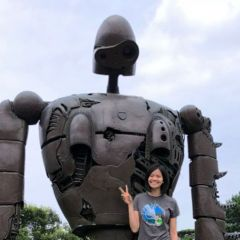 A UAH student poses with a sculpture in Saitama, Japan