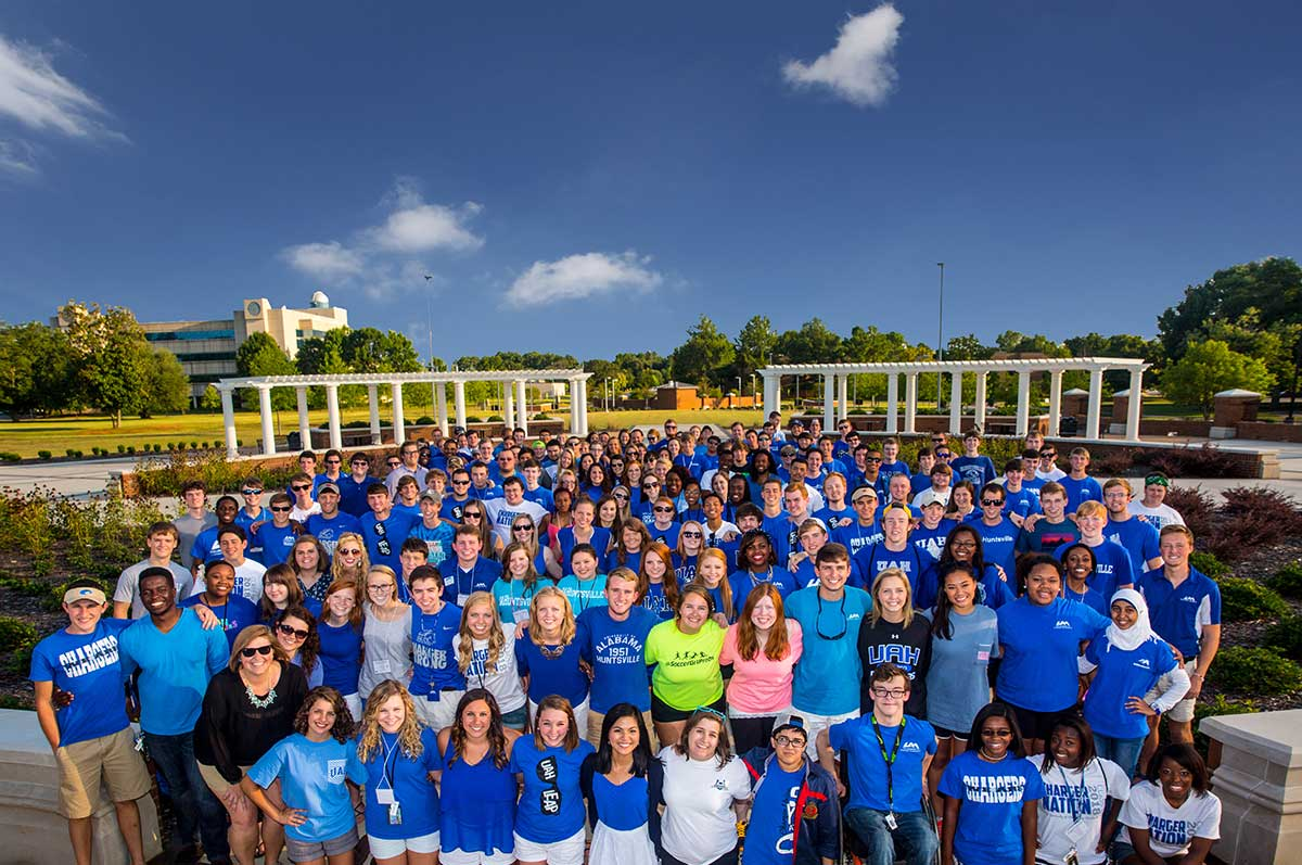 A large group of students in UAH apparel on the greenway
