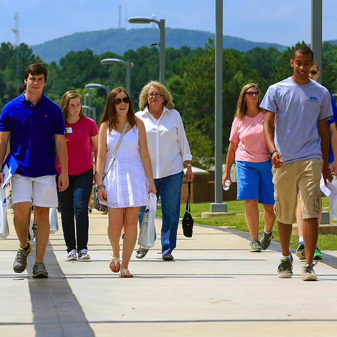 Prospective students and their families tour campus