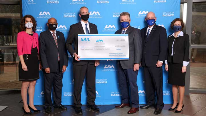 SAIC presents The University of Alabama Huntsville (UAH) with a $100,000 donation