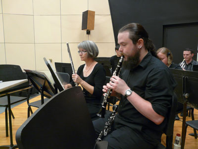 UAH graduates Amy Helser (flute) and Michael Wood (E-flat clarinet) warming up before dress rehearsal.