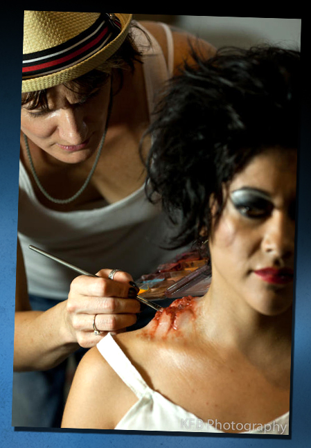 Michele Mulkey applies moulage makeup to actress Laura Montes.