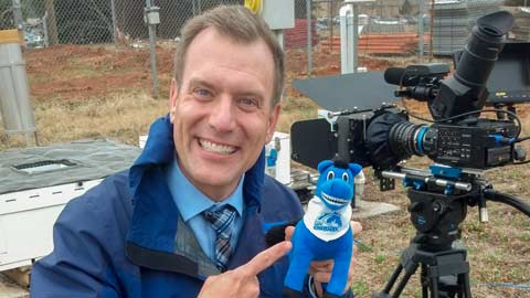 Mike Bettes takes a break with Charger Blue during 2014 Weather Channel coverage on campus.