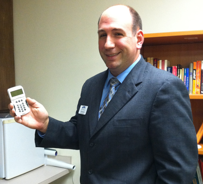 Assistant Dean of Students T.J. Brecciaroli holds one of the clickers being used in this semester's Charger Success 101 class.