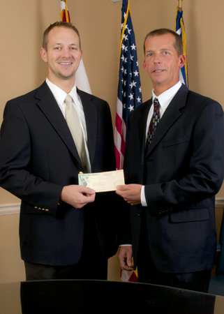 TVA Valley Relations Manager Jason Harper, left, provides a $5,000 grant to UAHuntsville's Electrical and Computer Engineering Department. Dennis Hite accepts the grant on behalf of the university.