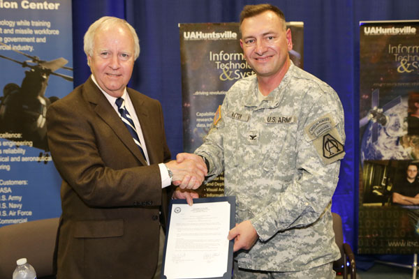 UAHuntsville President Dr. Robert Altenkirch and Col. Timothy Baxter signed a an agreement to explore opportunities for collaboration to promote the development of the next generation of Unmanned Aircraft Systems.Tuesday, April 16, 2013. Baxter is the Program Manager for Unmanned Aircraft Systems.