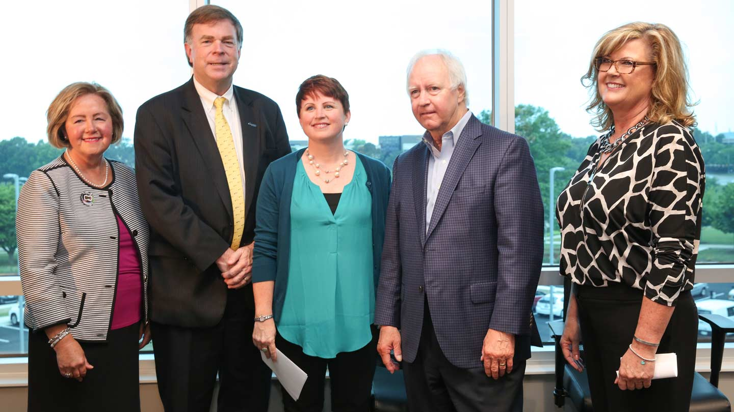 Judy Ryals of the Huntsville/Madison County Convention & Visitor's Bureau, Huntsville Mayor Tommy Battle, CRP Director Erin Koshut, UAH President Robert Altenkirch, and Vickie Palmer, Director of Operations for the Association of University Research Parks.