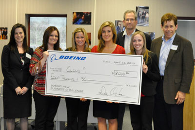 Winning team Cloud 9 receives an $8,000 scholarship check from Boeing executives.