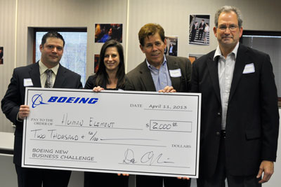 Winning team Human Element receives a $2,000 scholarship check from Boeing executives.