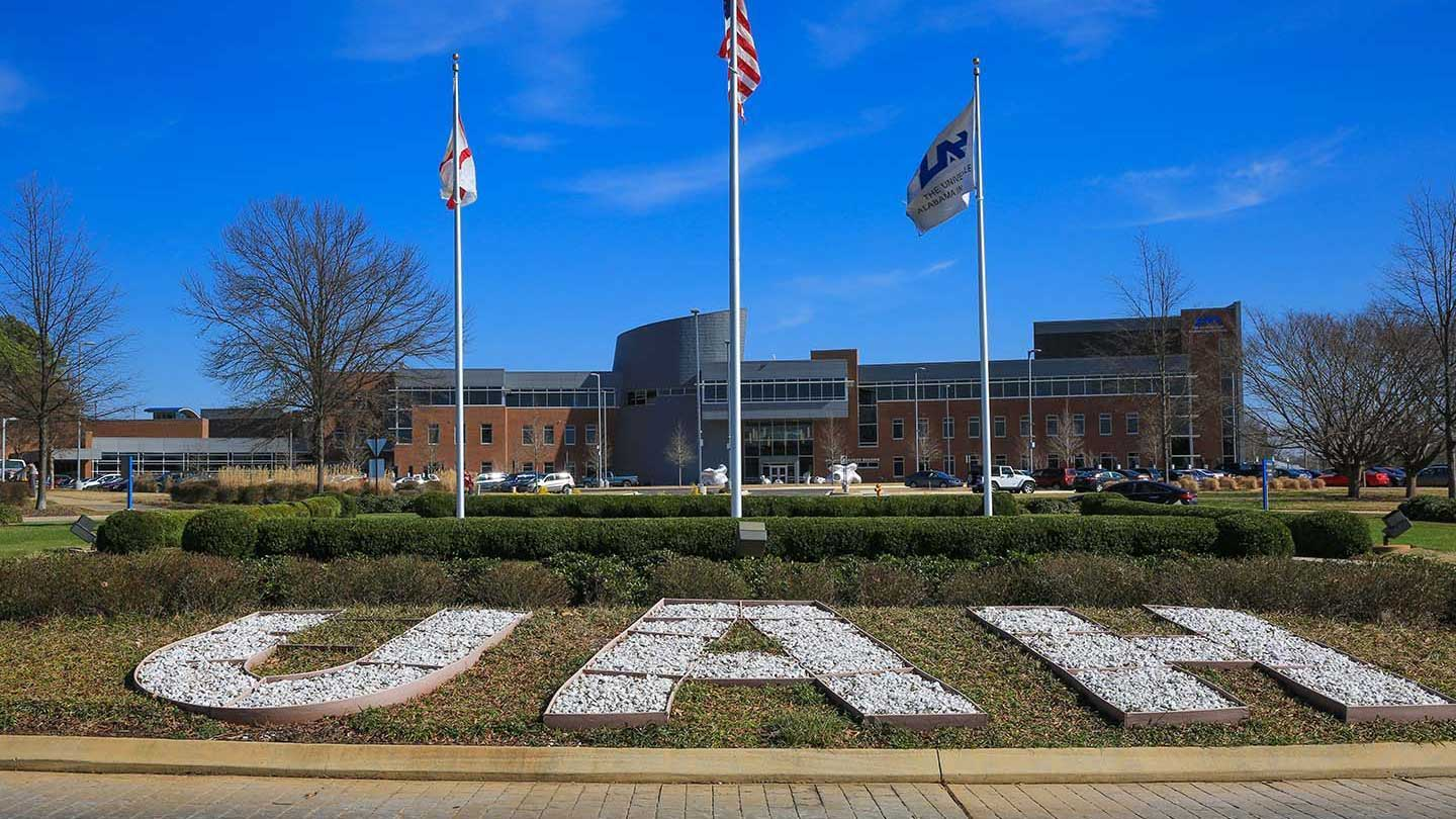 UAH campus with UAH letters painted on grass.