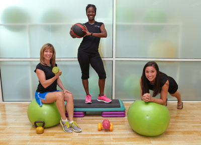 UFC's director of group fitness and facility programming Laurie Griffin, with group fitness instructors Tasha Edwards and Gloria Adhami, who is also a UAH student.