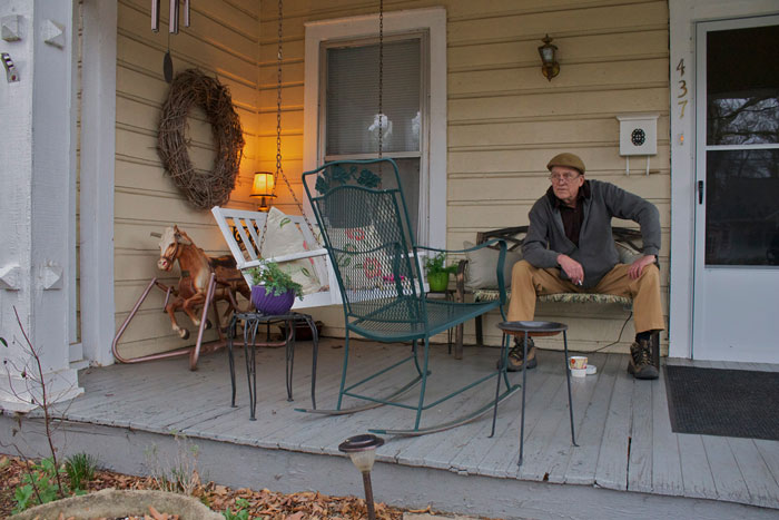 picture of a man sitting on a porch