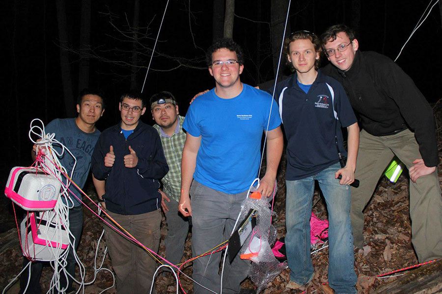 the Space Hardware Club's Takahiro 'Toby' Ishitobi, Geoff Suiter, Glenn Scott Nesbitt II, Eric Becnel, Andrew Perka and Trey McFerrin with the retrieved payload.