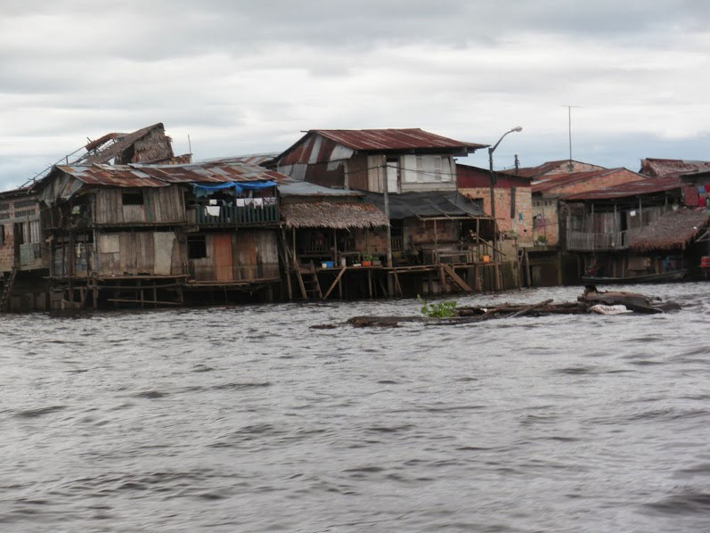 picture of worn buildings by the edge of water