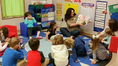 Patty reading to students