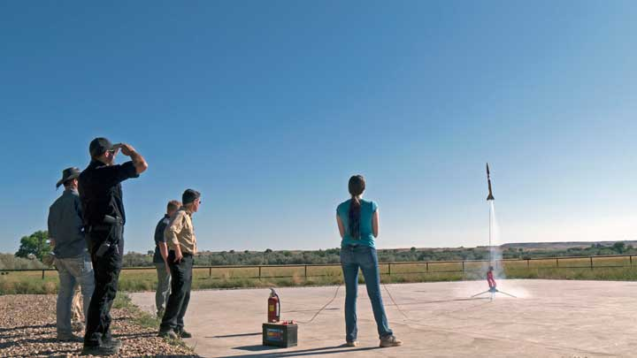 Five people launch a rocket.