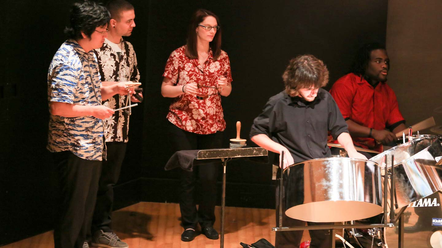 Members of the UAH steel drum band perform island classics