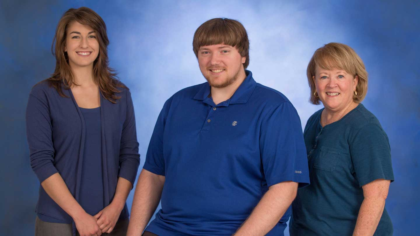 Alex Sims, president of the iSystems Club; Josh Deaton, vice president for projects of the iSystems Club; and Carolyn Rhodes, fitness coordinator at the Huntsville-Madison County Senior Center.