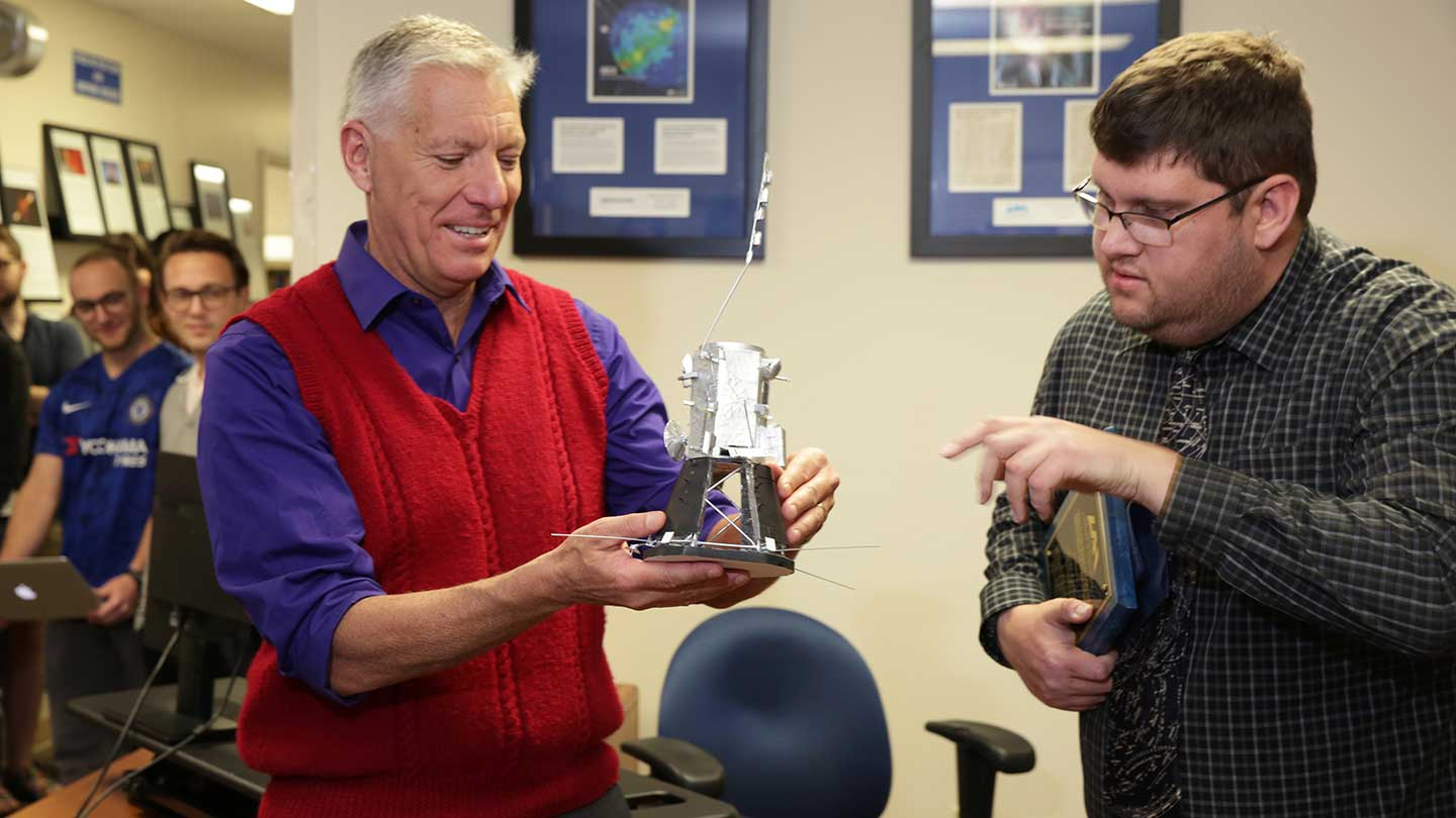 Blake Parker presenting the Parker Space Probe model to Dr. Gary Zank