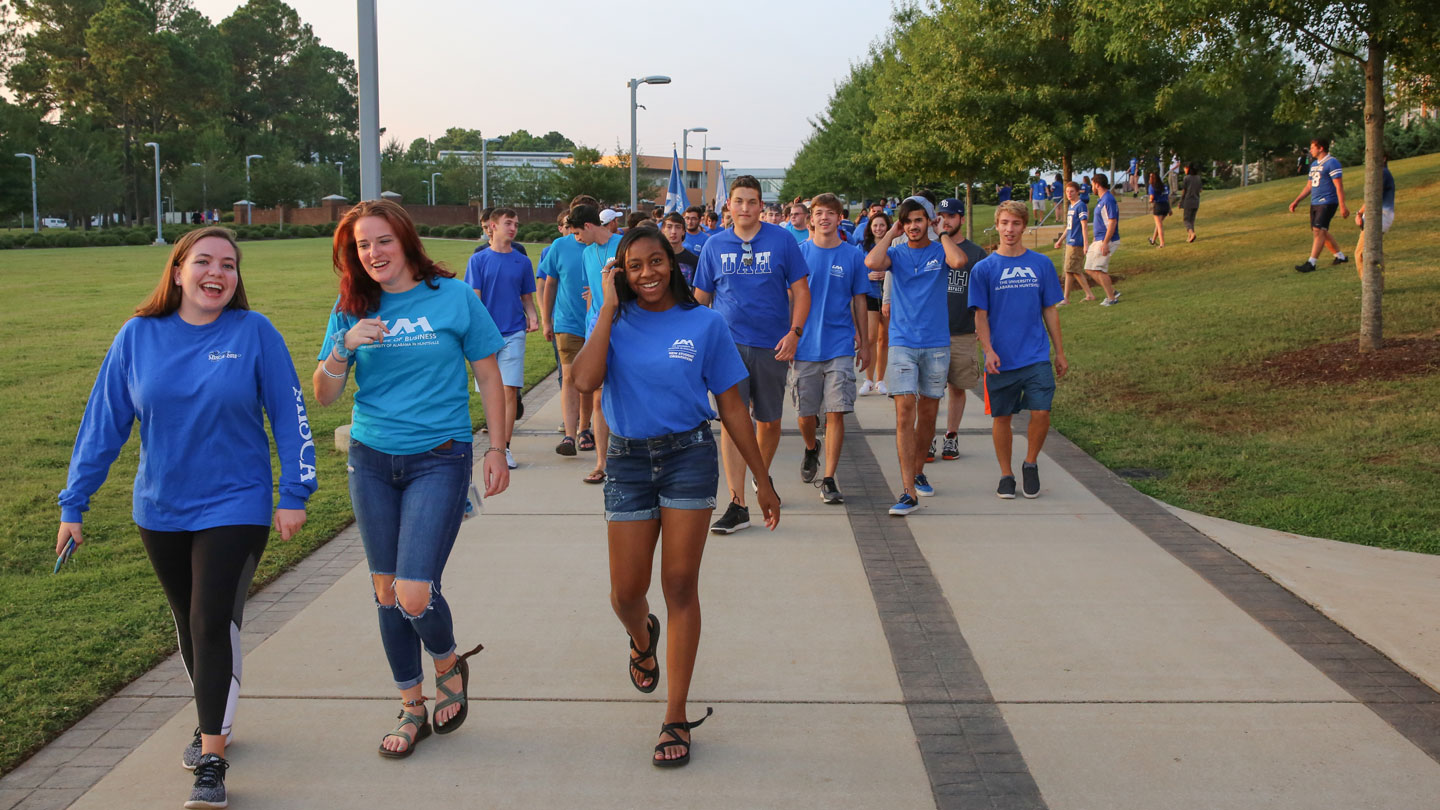Fall 2019 UAH students walk down the Greenway to Convocation