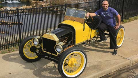 Seth Spratlin beside the 1914 Model T Ford originally bought by his great-great-grandfather.