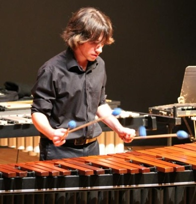 Justin Swearinger playing marimba for a percussion ensemble concert at UAH.