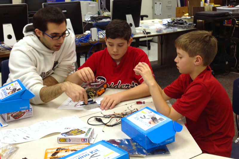 students in the TAG program working on electronics