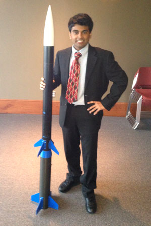 Charger Rocket Works' program manager Amit Patel with the team's rocket.