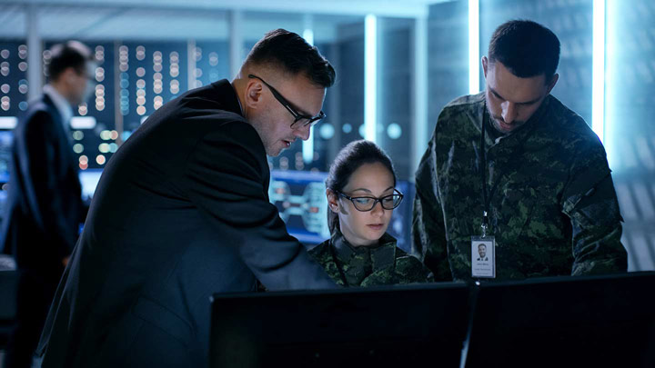 Military persons working on computers together